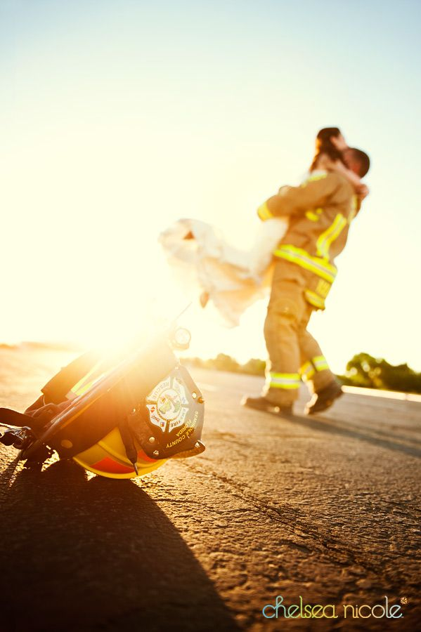 I WILL have a shot like this at my wedding! Love my fireman! <3