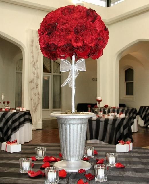 Topiary of red carnations and roses centerpieces