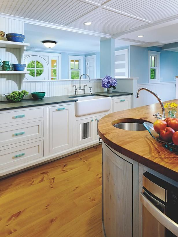 White kitchen cabinets light blue walls Cape cod style kitchen design