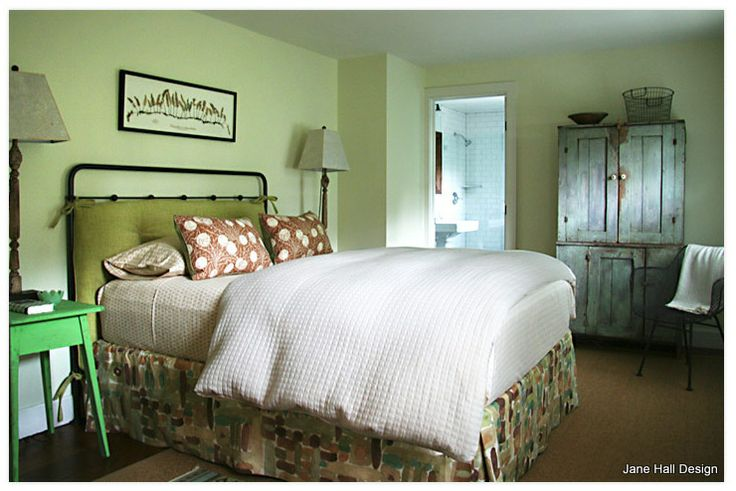 country style bedroom uses a soft and airy celery green on the walls