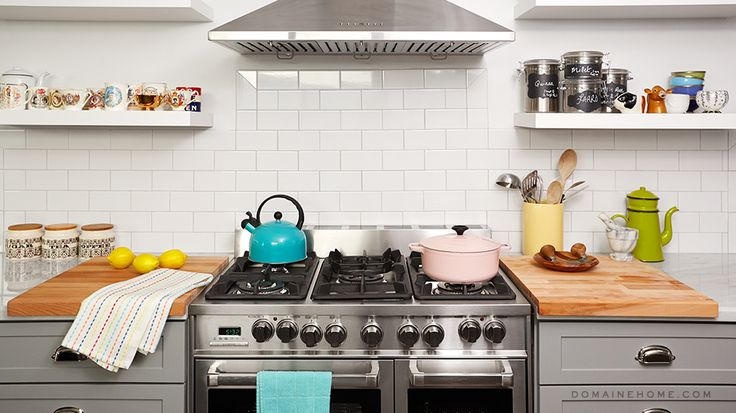 Before and After: A Dramatic DIY Home Renovation // gray kitchen cabinets, Carrara marble countertops, butchers block, steel hood, pink Le Creuset, open shelving