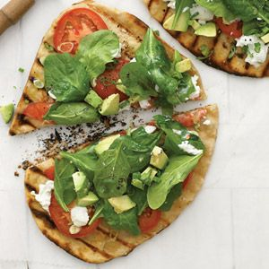 Grilled vegetable pizza with avocado, goat cheese and spinach