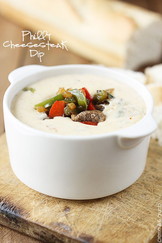 Ooey gooey queso dip with grilled peppers, onions, and tender steak ...