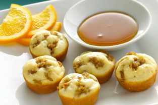 Mix pancake mix as directed and add cooked sausage crumbles. Spray mini muffin tin with Pam and full with pancake batter. Sprinkle the extra sausage on top and bake at 350 for 13 minutes or until golden brown. Serve with butter and syrup.
