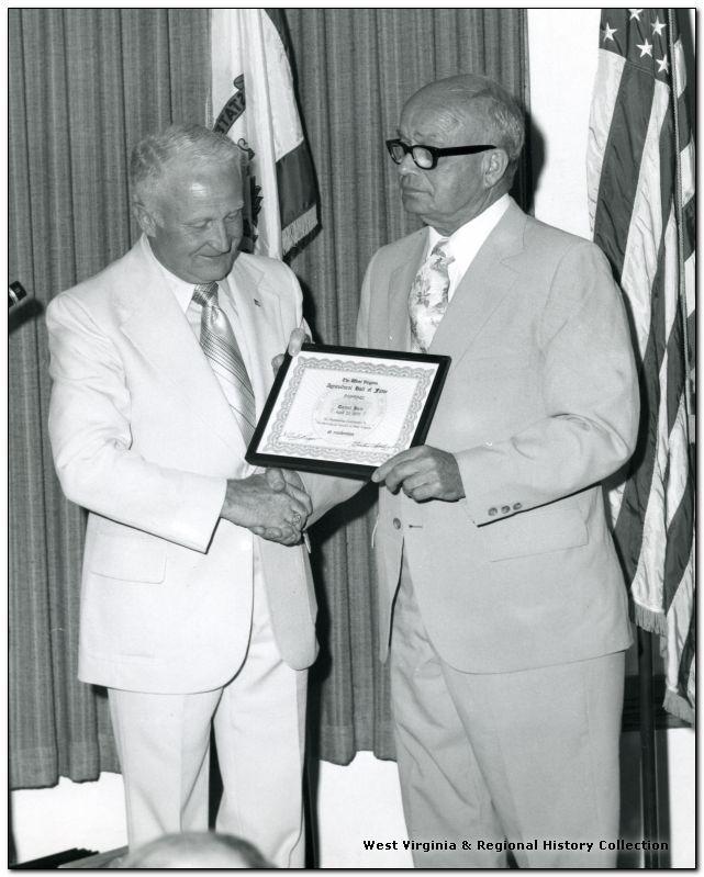 Dr. Dan Hale, receiving an award, West Virginia University