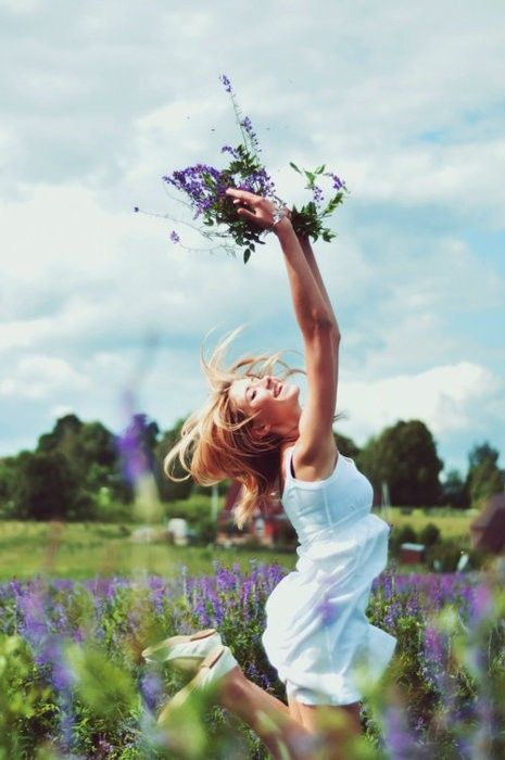 Girl frolicing in a field of flowers ... embracing freedom! via zsazsabellagio.blogspot.com.au
