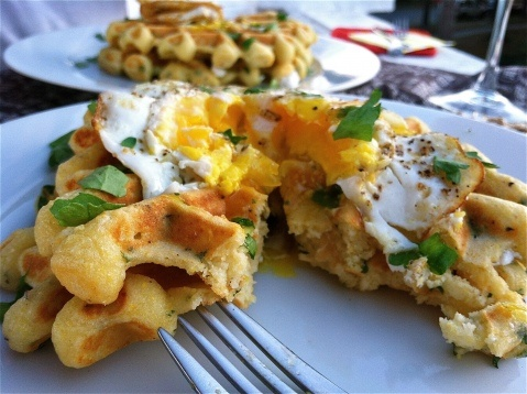 Savory cornmeal waffles with herbs, goat cheese and a fried egg ...