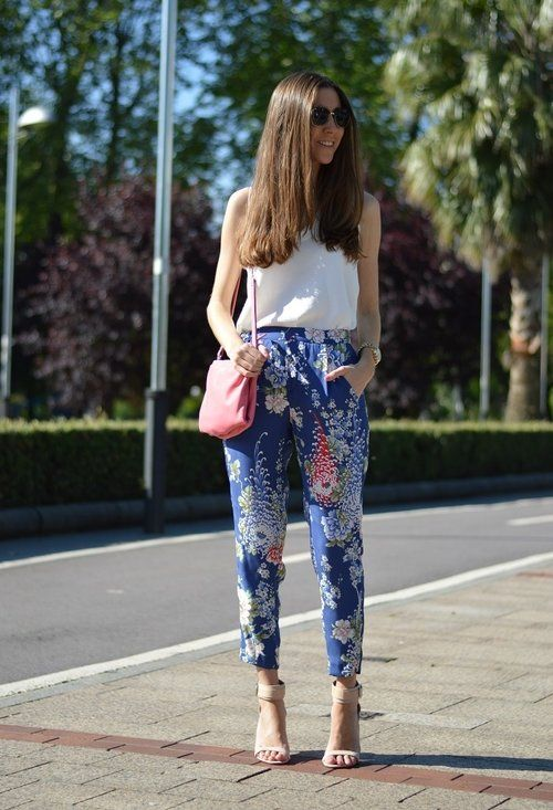 I LOVE floral prints. Especially are statement pants but are delicate at the same time. The shoes and shirt take a backseat to the pants, while the purse add just a perfect pop of pastel to tie it all together. One of my favorite summer looks. --ad.xx.