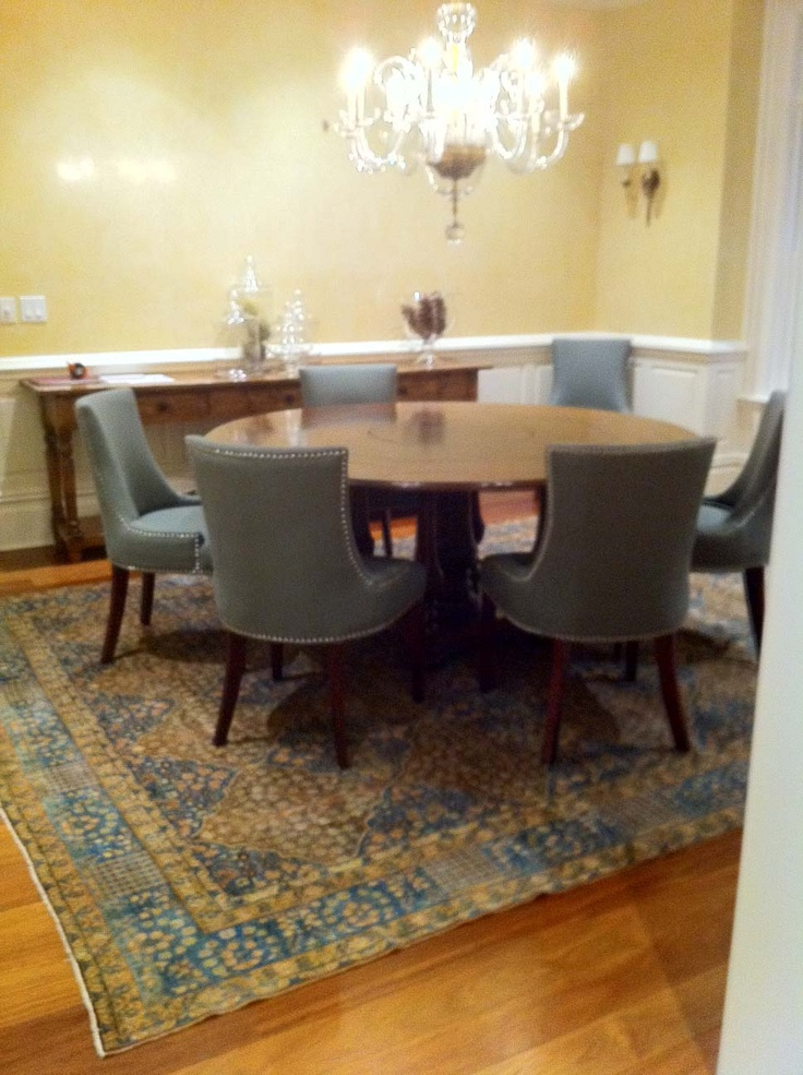 Dining table round dining table rugs for Dining room table on rug