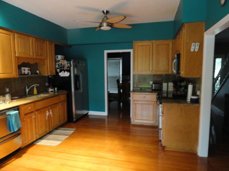 teal walls with off white cabinets  Kitchens  Pinterest