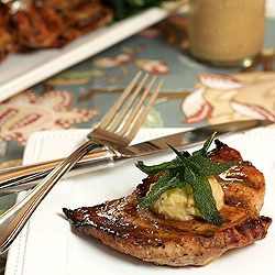 Barbecue pork steaks glazed with molasses, mustard and rum topped with ...