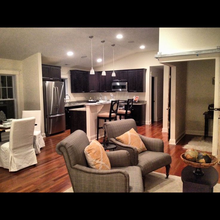 open floor plan with combo living room kitchen and dining room home