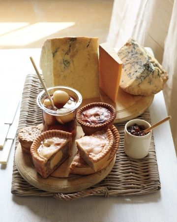 ... farmhouse cheddar, Cheshire, and Stilton, with pork pies, pickled