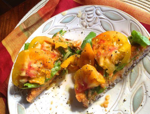 hummus sandwich with arugula and blush tomato on whole grain bread ...