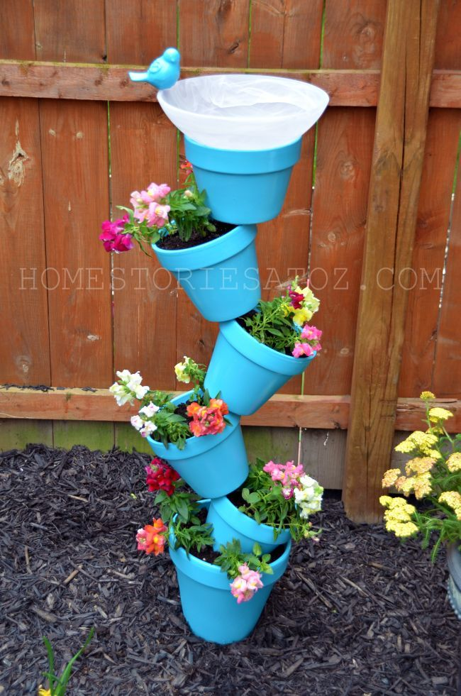 Birdbath Planter: 1-8″ terracotta pot for the base; 4-6″ pots; 1-4″ pot to place above the base; 62 inch piece of rebar; Plastic bowl. Spray paint of your choosing (Valspar is the one used in this pic.).