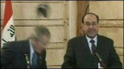 Shoes thrown at Bush on Iraq trip ~ A surprise visit by US President