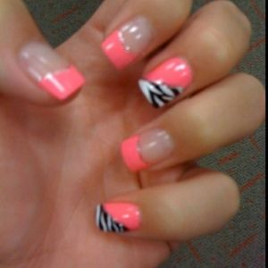 Coral colored nails with a hint of zebra print