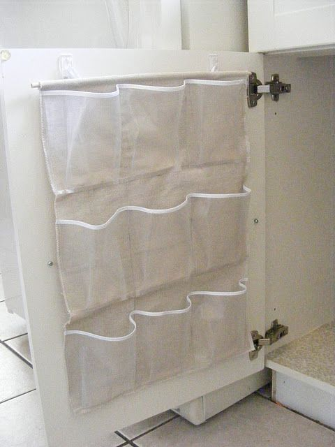 ...cut up a plastic shoe holder for bathroom's under counter storage...genius idea...