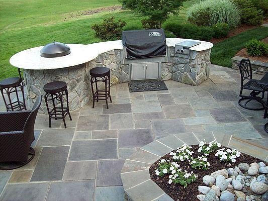 Stone patio & outdoor kitchen Yard Ideas