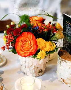 Centerpiece with flowers and books