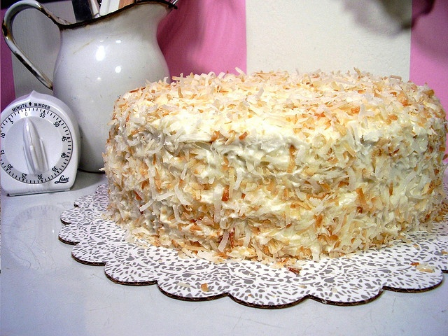 Decadent banana cake with coconut cream cheese frosting. Visit www ...
