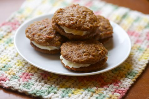 carrot cake sandwich cookies with citrus cream cheese frosting