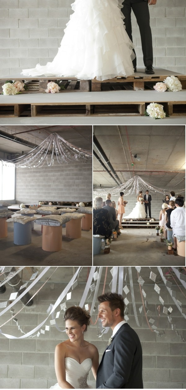 Industrial inspired wedding-Love the pallets and flowers (the pallets would need to be covered in something so it wouldn't snag the dresses) After reception while its cocktail hour pallet platform could be mr. and mrs. table