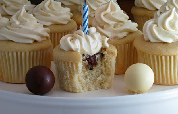 White cupcakes with truffle filling and white chocolate cream cheese ...