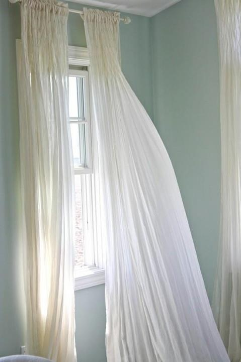 Sheer white curtains note placement of curtain rod to not hide the