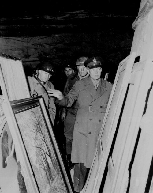 "Eisenhower, Patton, and General Omar Bradley inspect ""art treasures"" stolen by Nazis and hidden in a salt mine in Germany."