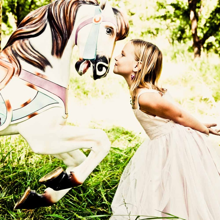 Girls with carousel horse.