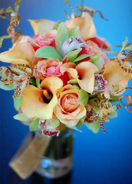 Bridal bouquet of Cherry brandy roses, calla lilies, cymbidium orchids and arachnid orchids