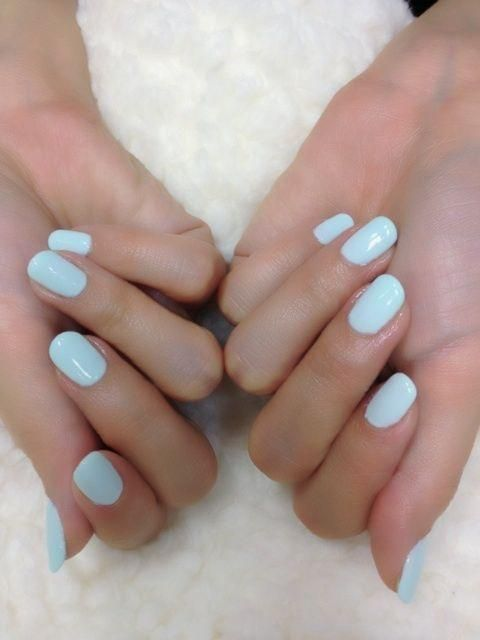 Ice blue nails.