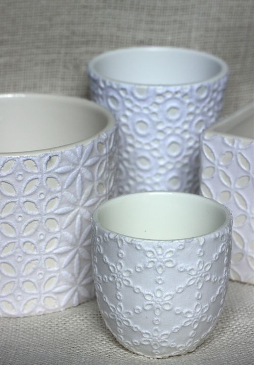 Mod podge lace or eyelet fabric onto container then spray paint. - For the office