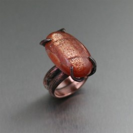 29.25 ct Sunstone Tree Branch Copper Ring - Work the mysterious angle with this Sunstone Copper Tree Branch Ring. The nature-inspired, handcrafted branch texture is highlighted with a rich orange colored 29.25 carat Sunstone cabochon that hints at your intriguing past ... and oh-so-stylish presence.