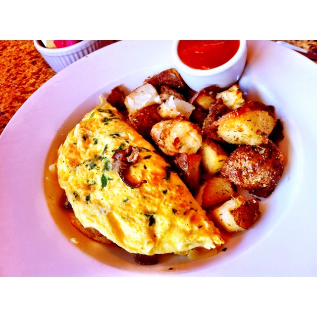 Wild mushroom, fontina and butter-browned leek omelet from The Country ...