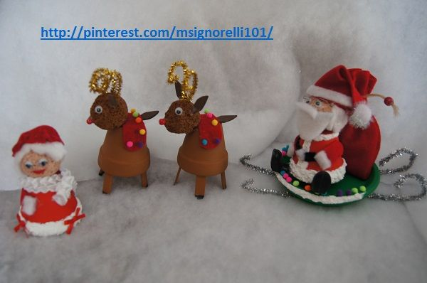 Christmas clay pot santa on his sled mrs claus and the reindeers for
