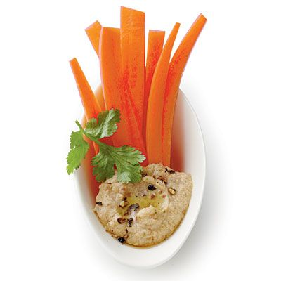 Hummus with carrots garnished with cilantro