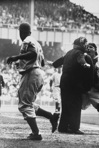 """Game 1, 1955 World Series.  Yogi Berra begs to differ with the ump's call of """"safe.""""  That's Jackie."""