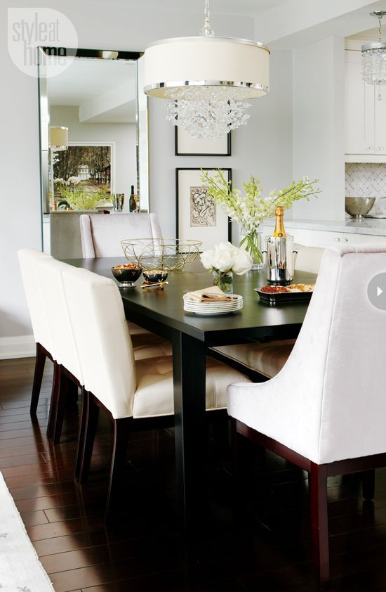 Dining room-by Meredith Heron The simple espresso-stained Parsons-style dining table can extend to seat up to 12 people. The plush upholstered end chairs and dining chairs are comfortable enough to sit in for hours, allowing guests to linger longer after dinner.