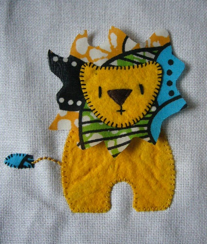 """Felt Lion  """"My first task in progress is a present for a friends baby, I've been meaning to get it finished for ages. So far I have a lion, next comes the acacia tree and maybe agiraffe. I've used African printed fabric to add a traditional element to the project."""""""