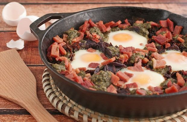 Skillet Baked Eggs with Potatoes Pesto and Sun Dried Tomatoes