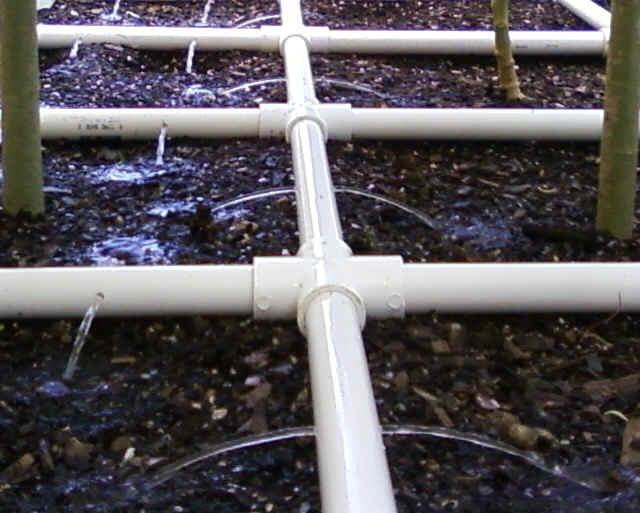 Closeup of PVC Watering Grid Greenhouse Garden Pinterest