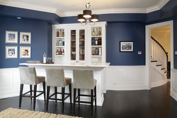 Love the navy and white paneling, and the silver frames with pink accents