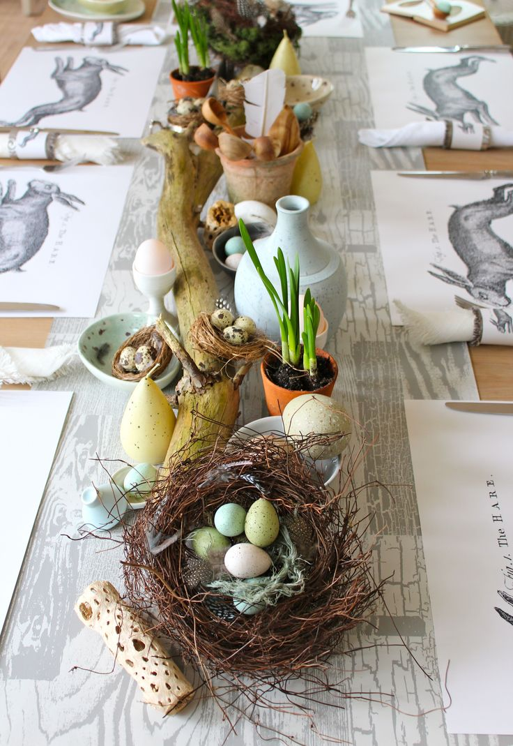 easter table with lots of DIY elements, including hare placemats and napkin rings