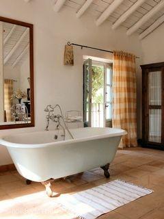 Roll top bath in bedroom