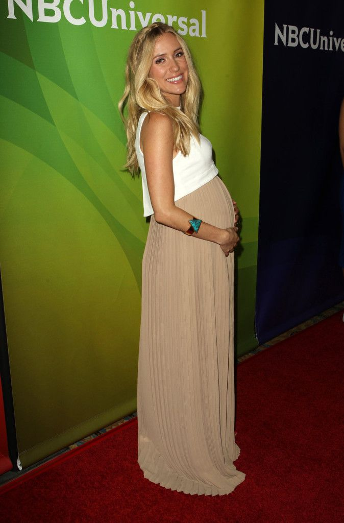 Kristin Cavallari's Maternity Style - adorable to layer a crop top over a dress! #maternity