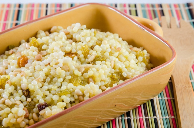 Saffron Israeli Couscous with pine nuts and raisins. This dish is ...
