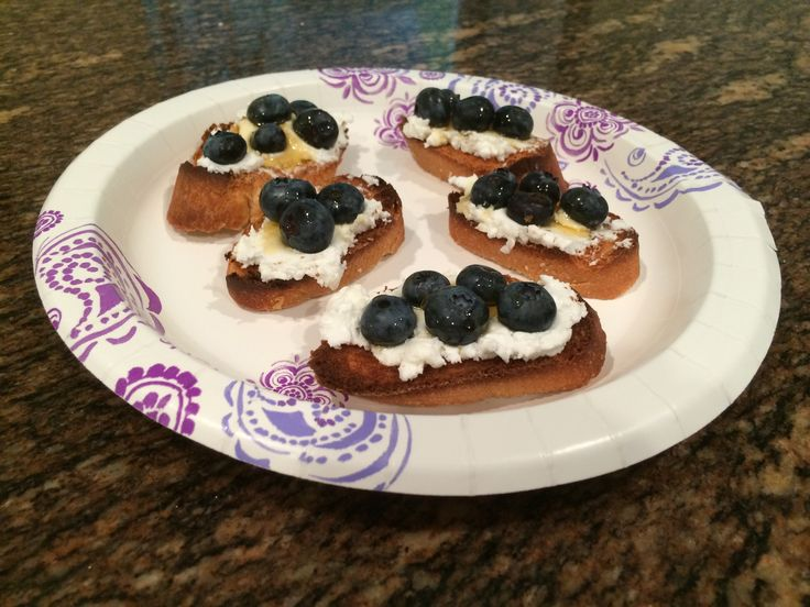 An afternoon #snack of crostini. Goat cheese, fresh blueberries, and mountain honey on toasted baguette slices.