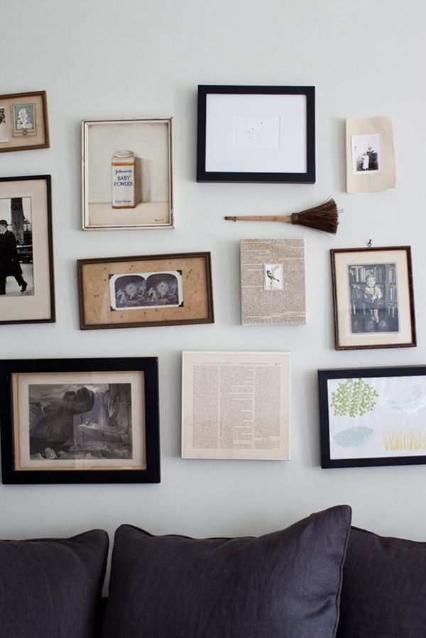 frames over sofa  donna griffith via covet garden